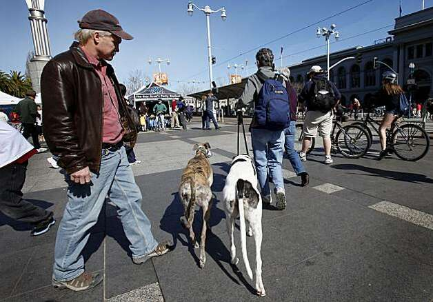 Many people brought their pets out to exercise on the Embarcadero at San Francisco's first Sunday Streets event of the year, which shut down the Embarcadero from the AT&T Park to Pier 45. Photo: Brant Ward, The Chronicle