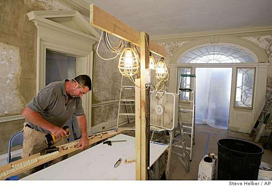 Restoration specialist Dan Copeland, works on molding in the drawing room of Montpelier, the restored home of former President James Madison, in Orange, Va., Wednesday, Aug. 13, 2008.  (AP Photo/Steve Helber) Photo: Steve Helber, AP