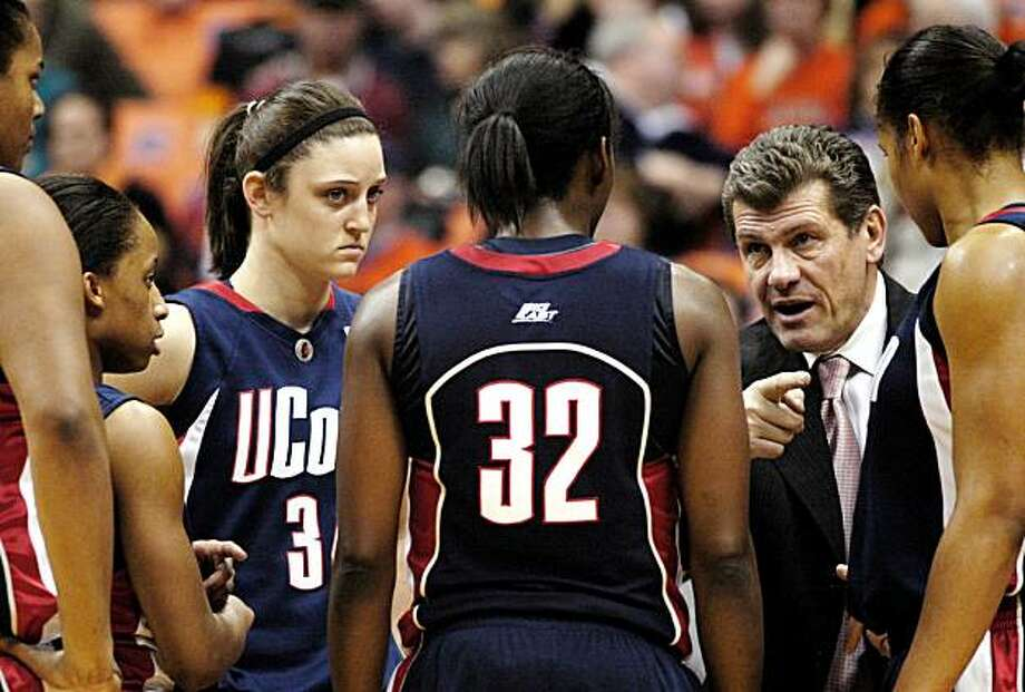 In this Feb. 24, 2010, file photo, Connecticut coach Geno Auriemma, right, talks to his players during a timeout against Syracuse in an NCAA college basketball game in Syracuse, N.Y. Connecticut faces Southern University on Sunday in the first round of the NCAA tournament. Photo: Kevin Rivoli, AP