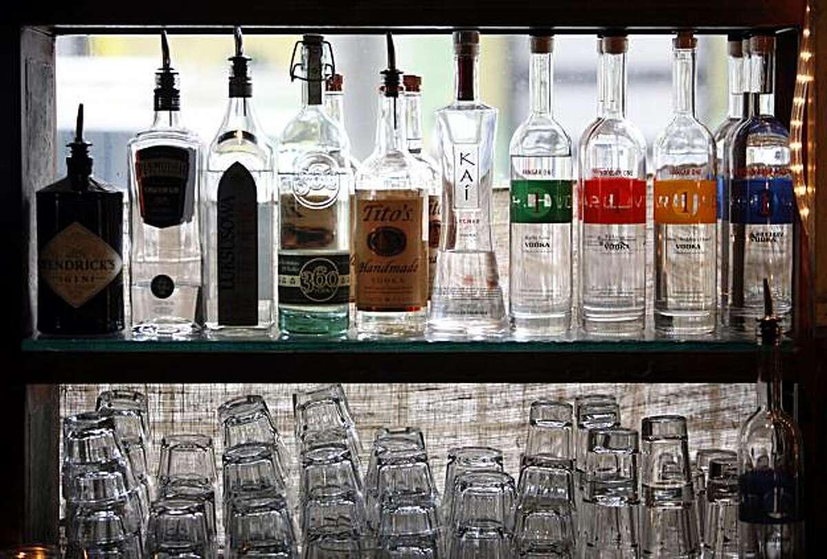 Liquor bottles seen at a bar.