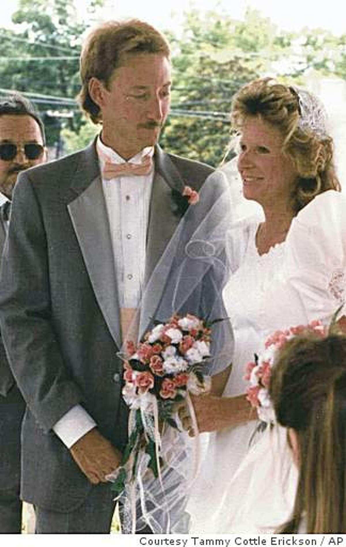In this photo provided by Tammy Cottle Erickson; Terry Cottle and Cheryl Sweat are seen during their wedding ceremony on May 13, 1989, in South Carolina. (AP Photo/Courtesy of Tammy Cottle Erickson) **NO SALES**