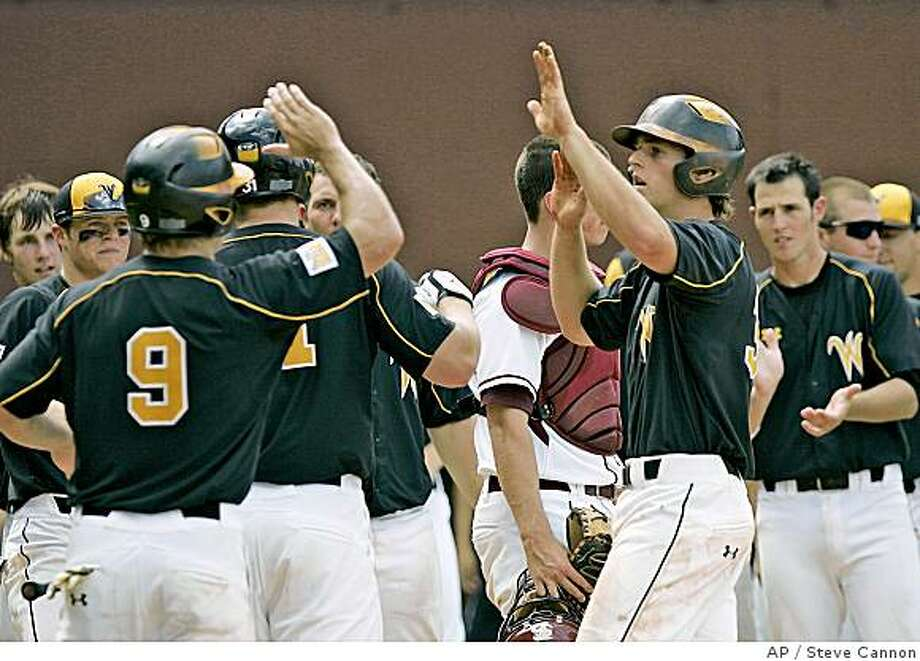 **CORRECTS SPELLING OF PLAYER'S FIRST NAME TO CONOR, NOT CONNOR** Wichita State's Conor Gillaspie, right, celebrates a three-run home run against Florida State in the sixth inning of the Tallahassee Super Regional baseball game Friday, June 6, 2008, in Tallahassee, Fla.  Wichita State won 10-7. (AP Photo/Steve Cannon) Photo: Steve Cannon, AP