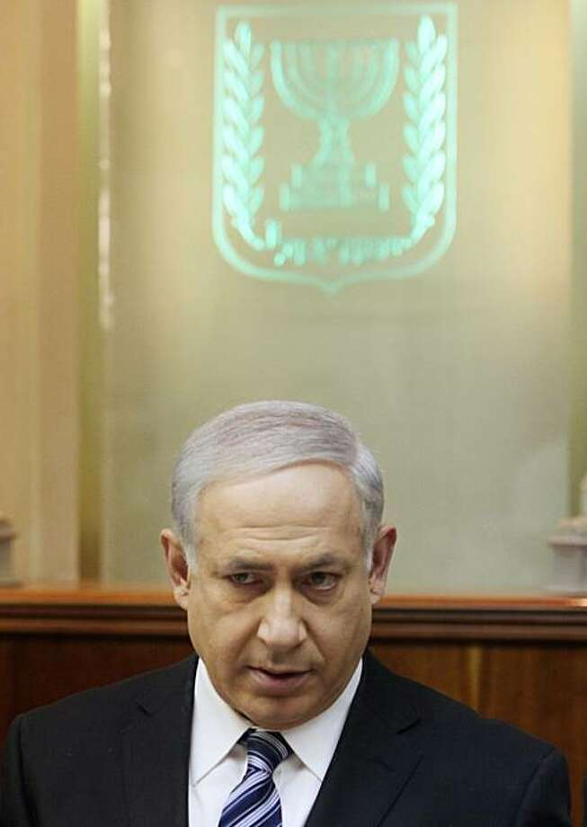 Israeli Prime Minister Benjamin Netanyahu chairs the weekly cabinet meeting in his office in Jerusalem Sunday, March 14, 2010. Netanyahu is urging calm following another stern rebuke from Washington over plans to build 1,600 apartments in contested east Jerusalem. Photo: Jim Hollander, AP
