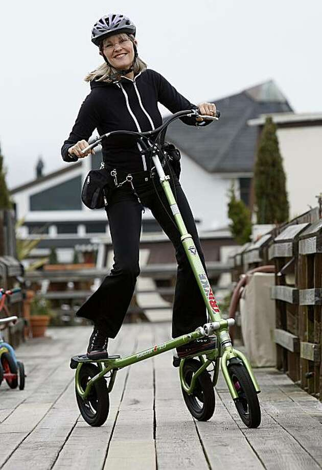 Caroline MacNeill Hall likes riding a three-wheeled scooter called a Trikke in Sausalito, Ca., on Thursday, February 19, 2010.  She says it's a great upper and lower body workout. Photo: Liz Hafalia, The Chronicle