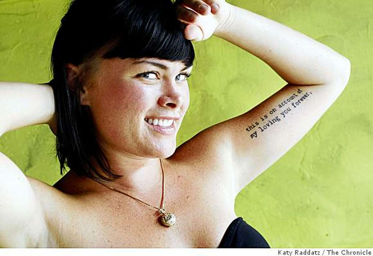 Beth Loster shows the script tattoo on her left arm, which says,