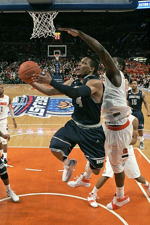 Georgetown's Chris Wright (4) drives past Syracuse's Rick Jackson during the second half of a quarterfinal round NCAA college basketball game at the Big East Conference Championships Thursday, March 11, 2010  in New York. Wright scored 27 points as Georgetown won the game 91-84. Photo: Frank Franklin II, AP