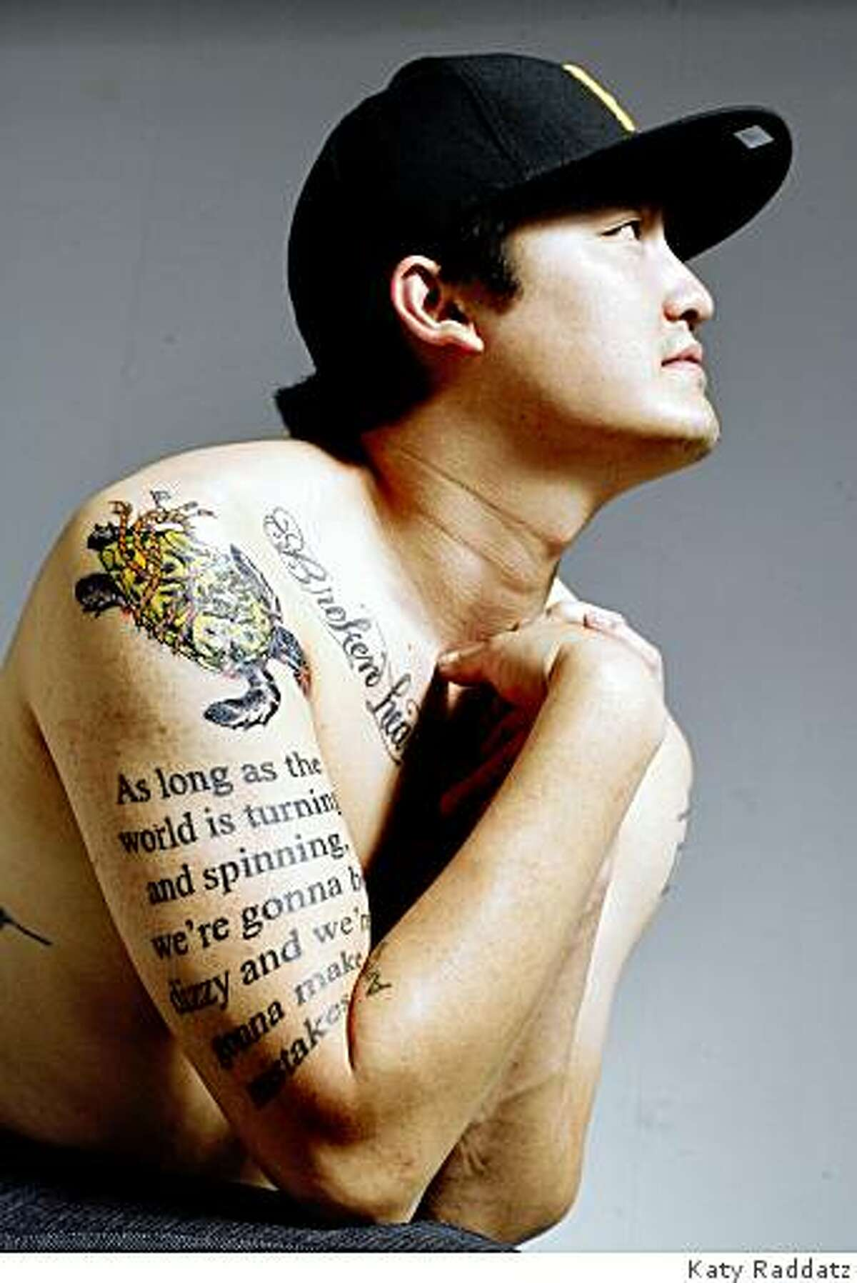 Jon Woo has many tattoos, including a script tattoo on his right upper arm that is a quote from Mel Brooks: