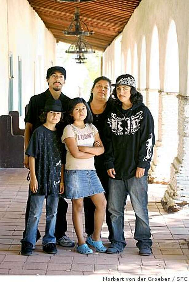 (L-R) Jeremiah Martinez,  Atlixcatzin Pacheco, 8, Ana?s Pacheco, 9,  Graciela Serna Nutter, and Adrian Pacheco, 15, are all family members that at one time have been a ensemble members of El Teatro Campesino. Photo taken on Saturday, August 30, 2008, at Old Mission San Juan Bautista..   Graciela Serna Nutter is a veteran actress with El Teatro Campesino, the Hispanic theater company based in San Juan Bautista. Graciela's late parents acted with the company. so did her four children. And now her grandchildren are involved -- four generations. She, her children and grandchildren also have their own theatrical collective, called Indigenous Chaos. Photo: Norbert Von Der Groeben, SFC