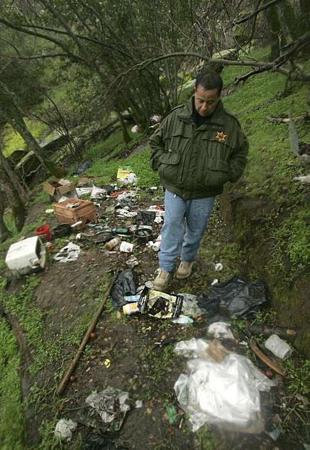 In this photo taken Wednesday, Jan. 20, 2010, Fresno County Sheriff's Lt. Rick Ko walks through a camp site at an abandoned marijuana growing site in the Sequioa National Forest near Fresno, Calif.  With billions of dollars in drug profits on the line, Mexican traffickers are expanding their foothold in the domestic marijuana market taking over vast swaths of public lands. Photo: Rich Pedroncelli, AP