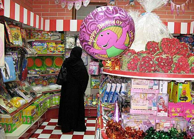 A woman looks for a birthday item at a gift shop in Riyadh, Saudi Arabia, Wednesday Sept. 3, 2008. The mixed attitude in Saudi Arabia toward birthdays was reflected recently in an unusual public controversy over the issue, with one prominent cleric saying there's nothing un-Islamic about them and another, Sheik Abdul-Aziz Al Sheik, the kingdom's grand mufti and top religious authority, strongly opposing them. (AP Photo/Hassan Ammar) Photo: Hassan Ammar, AP