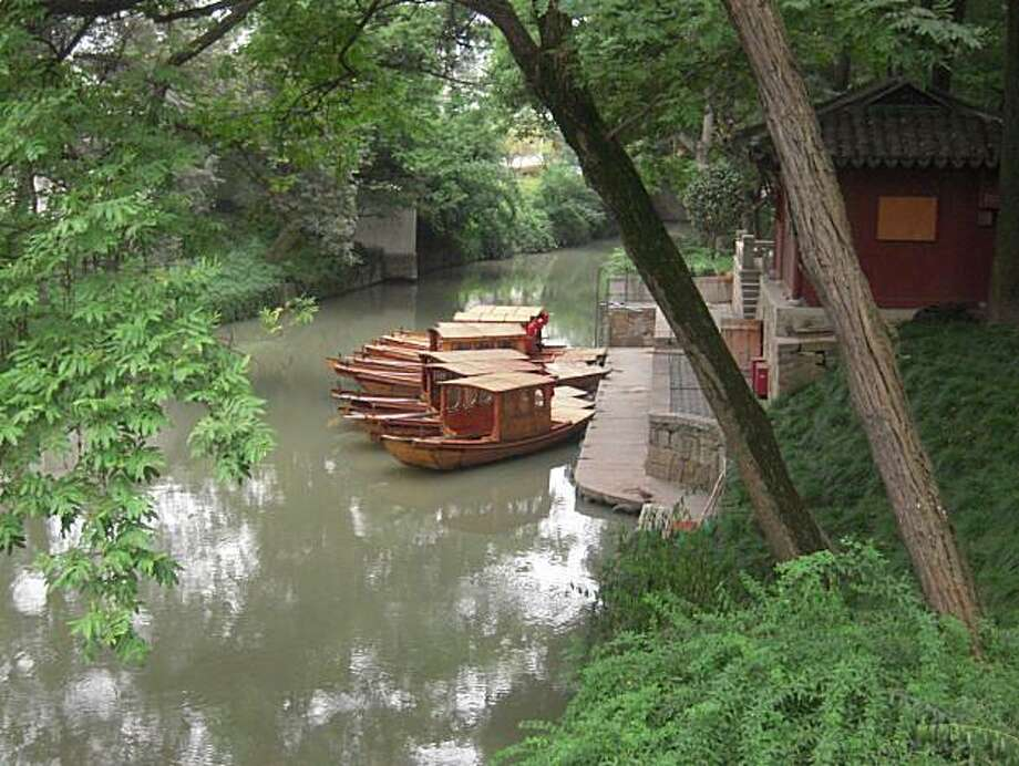 Canal boats in Suzhou, China. Photo: Georgina Armstrong, Special To The Chronicle