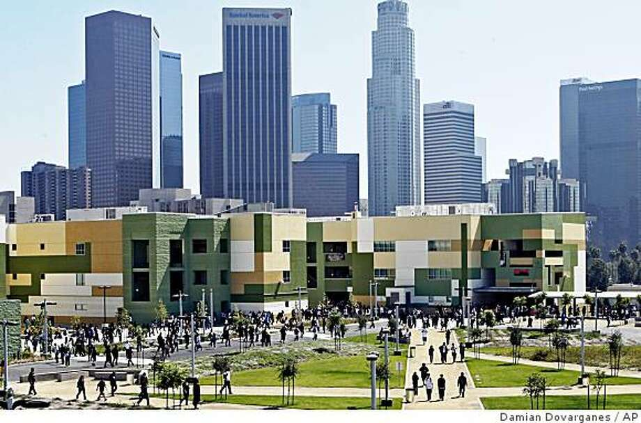 """Students are seen at the newly-opened """"Edward R. Roybal Learning Center in downtown Los Angeles, Wednesday, Sept. 3, 2008.  A decade behind schedule, this $350 million high school has finally opened in downtown Los Angeles after years of environmental, seismic and legal troubles. More than 2,000 students streamed into the Edward R. Roybal Learning Center on Wednesday, Sept. 3, 2008, years after it was planned as an education showplace to relieve overcrowded classrooms. (AP Photo/Damian Dovarganes) Photo: Damian Dovarganes, AP"""