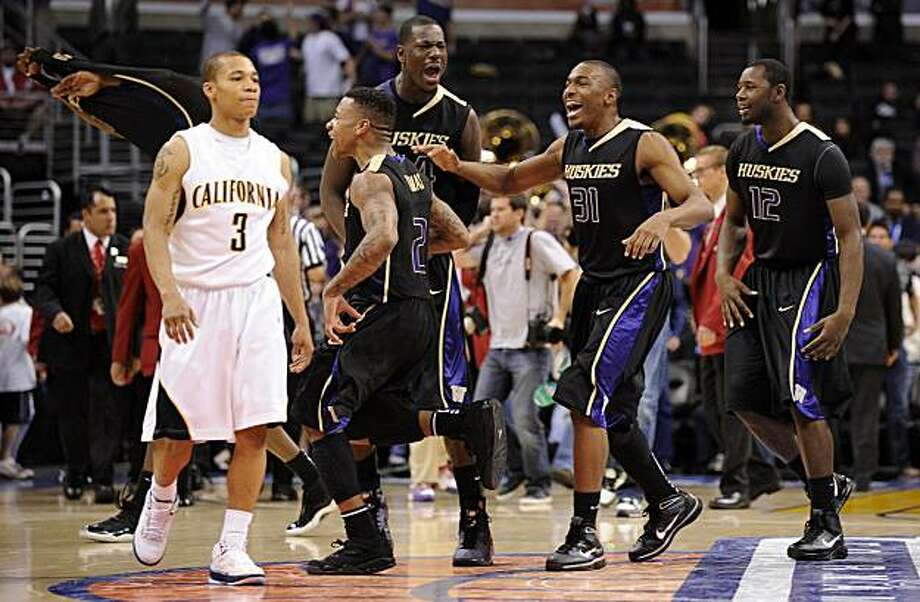 Washington players celebrates as California's Jerome Randle, left, walks off the court after an NCAA college basketball game at the Pac-10 Conference tournament, Saturday, March 13, 2010, in Los Angeles. Washington won 79-75. Photo: Mark J. Terrill, AP