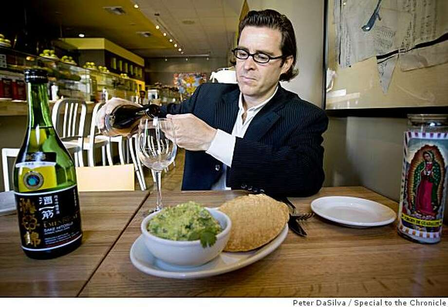 True Sake owner Beau Timkin prepare see how a bottle of ChiKurin Sake (brown bottle) will pair with guacamole and chips while on his quest to pair sake with non Japanese food at Regalito  Rosticeria in San Francisco, California, Aug. 31, 2008.Photo By: Peter DaSilvaSpecial to the Chronicle Photo: Peter DaSilva, Special To The Chronicle