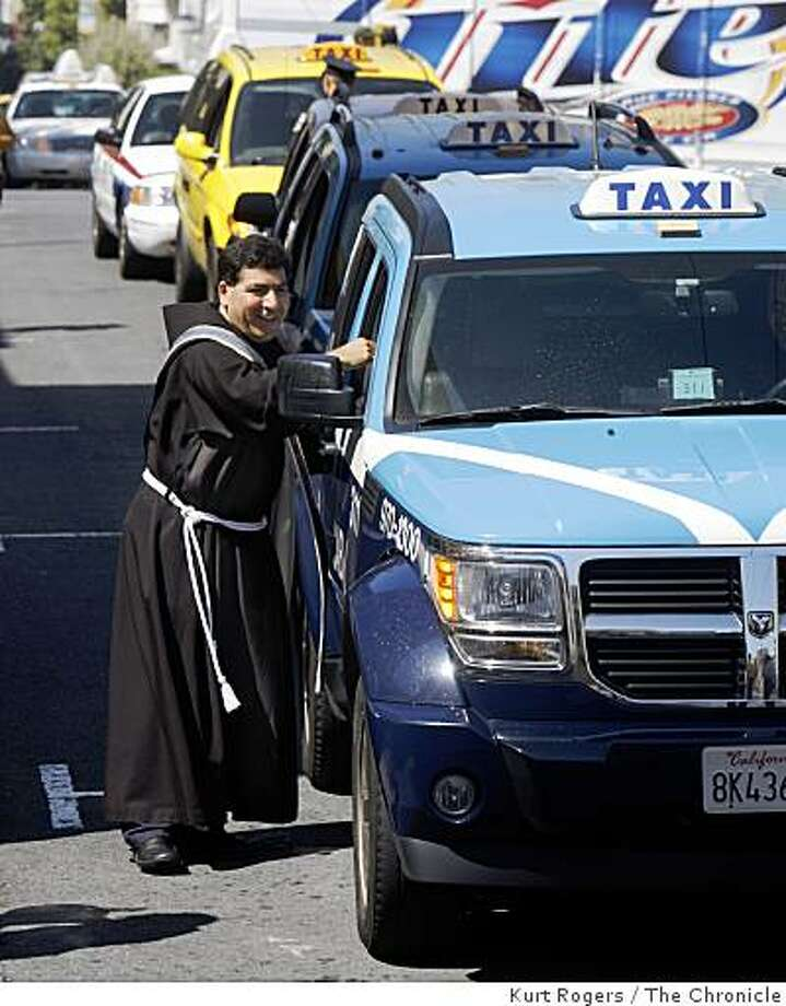 Father Jorge Hernandez of the St. Boniface Church in the Tenderloin blesses taxi cabs that lined up on Golden Gate Avenue on Thursday, Sept. 4, 2008 in San Francisco, Calif. Photo: Kurt Rogers, The Chronicle
