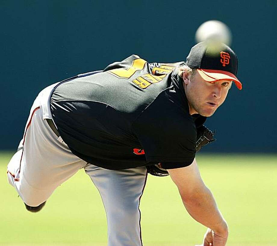San Francisco Giants starting pitcher Todd Wellemeyer warms up to work the first inning against the Colorado Rockies in a Cactus League spring baseball game in Tucson, Ariz., on Friday, March 12, 2010. Photo: Ed Andrieski, AP