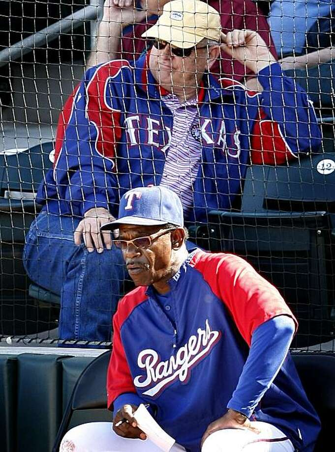 Texas Rangers' Nolan Ryan (top) and manager Ron Washington keep an eye on spring training game against the Kansas City Royals at Surprise Stadium in Surprise, Arizona, on Saturday March 6, 2010. (Ron Jenkins/Fort Worth Star-Telegram/MCT) Photo: Ron Jenkins, MCT