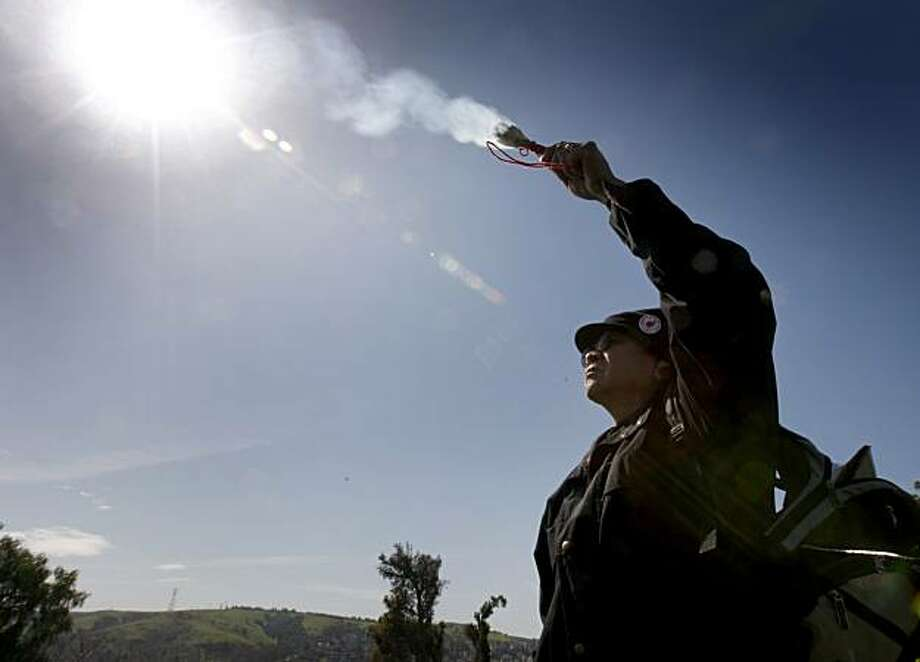 Norman Deocampo burns sage to bless the site of the proposed waterfront Glen Cove Park in Vallejo, Calif., on Thursday, March 11, 2010. Native Americans are fighting the proposed development which they say is sacred Ohlone burial ground. Photo: Paul Chinn, The Chronicle