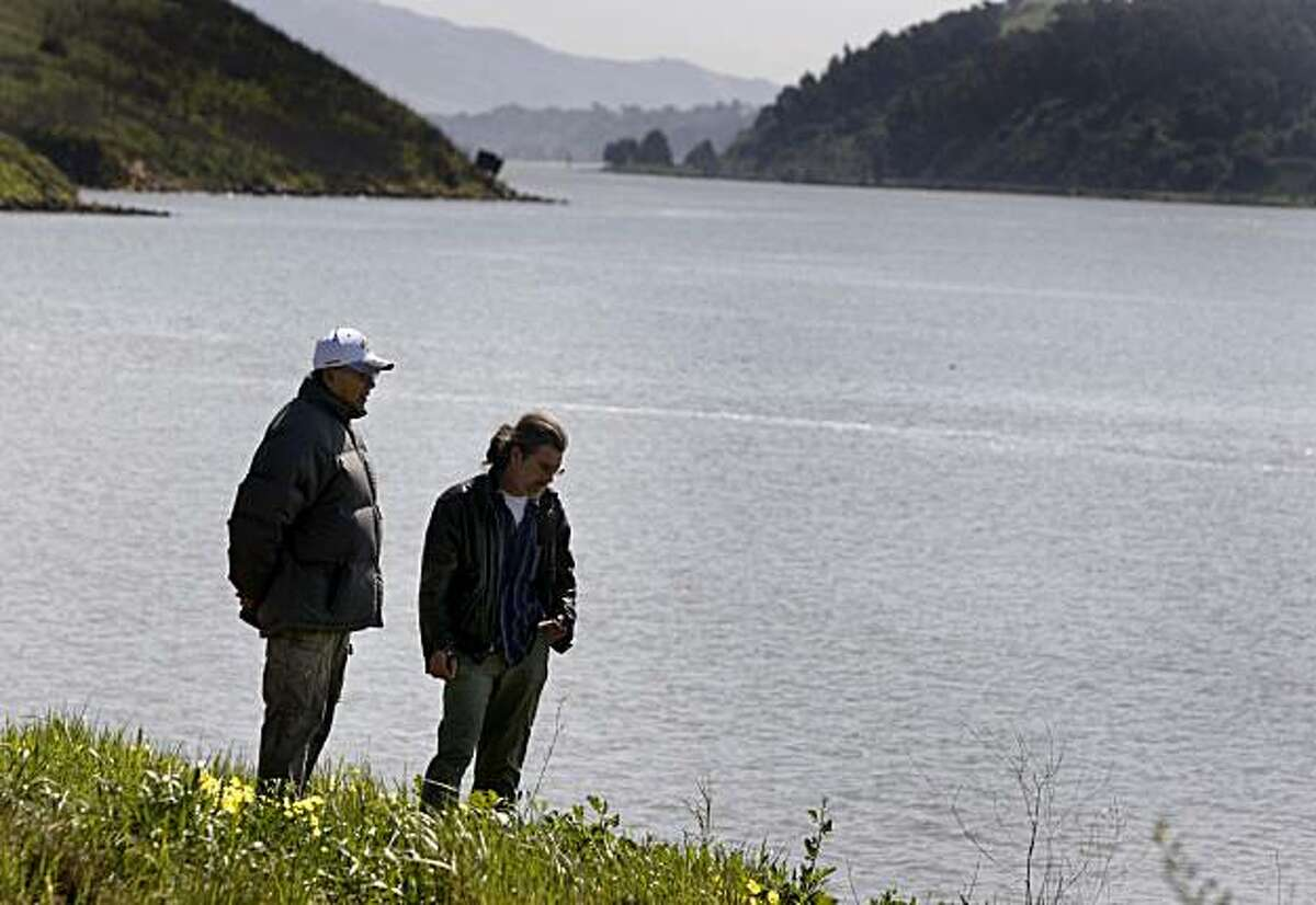 Tino Deocampo (left) and Walt Copenhaver pause on a bluff overlooking the Carquinez Strait on the site of a proposed waterfront Glen Cove Park in Vallejo, Calif., on Thursday, March 11, 2010. Native Americans are fighting the proposed development which they say is sacred Ohlone burial ground.
