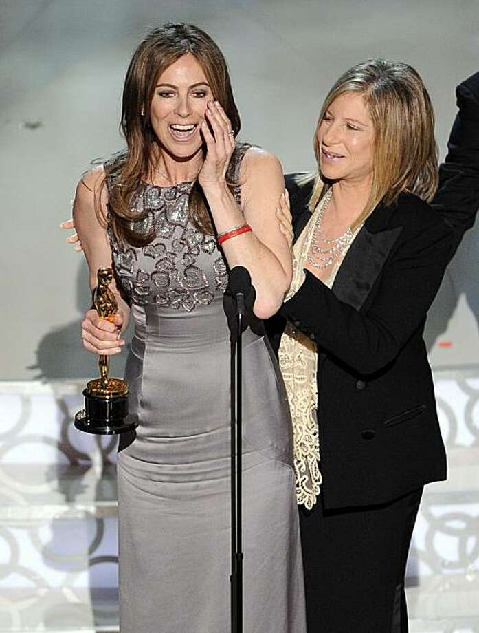 ** CORRECTS SPELLING OF BARBRA ** Kathryn Bigelow accepts the Oscar for best achievement in directing for ?The Hurt Locker? from presenter Barbra Streisand at the 82nd Academy Awards Sunday, March 7, 2010, in the Hollywood section of Los Angeles. Photo: Mark J. Terrill, AP