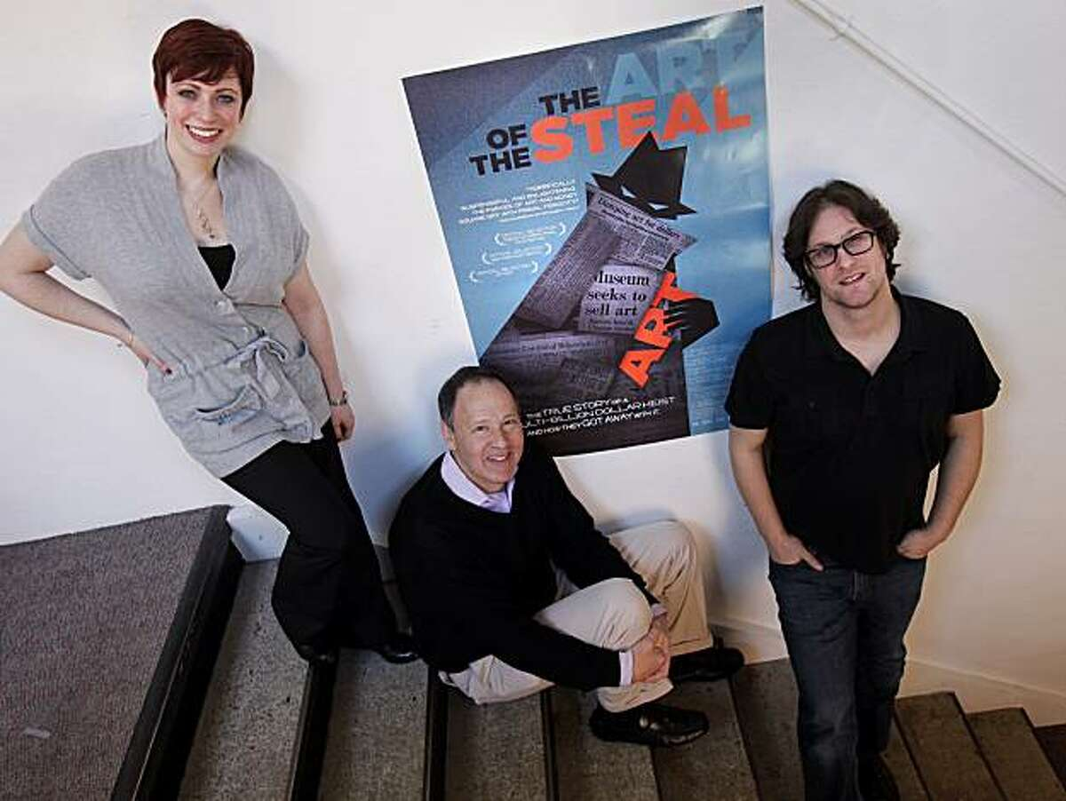 """A new documentary movie called """"The Art of the Steal"""" is about the fortunes of a large art collection back east. Standing with a poster of their film February 16, 2010 in San Francisco, Calif. are producer Sheena M. Joyce (left), executive producer Lenny Feinberg (seated) and director Don Argott."""