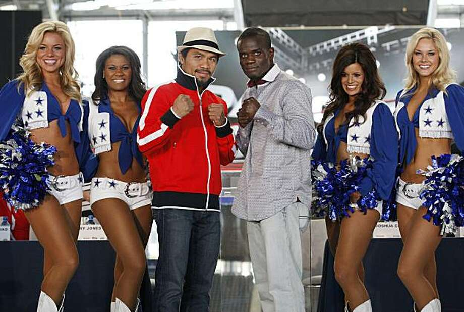 Manny Pacquiao, left, and Joshua Clottey pose for photos at Cowboy Stadium in Arlington, Texas, Wednesday, March 10, 2010. Pacquiao will face Clottey on Saturday night. (Paul Moseley/ Fort Worth Star-Telegram/MCT) Photo: Paul Moseley, MCT