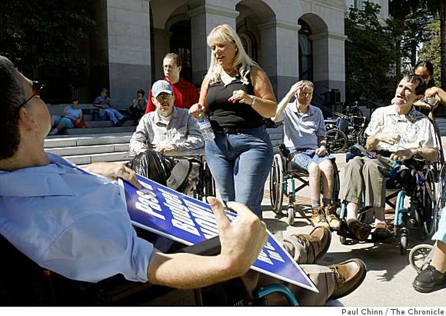 Sarane Collins (center), who operates three long term health care facilities in Santa Rosa, brought her 18 clients to a demonstration at the state capitol in Sacramento, Calif., on Friday, Sept. 5, 2008. Health care providers dependent on Medi-Cal payments held the rally to demand that lawmakers pass a state budget and release critical health care funds. Photo: Paul Chinn, The Chronicle