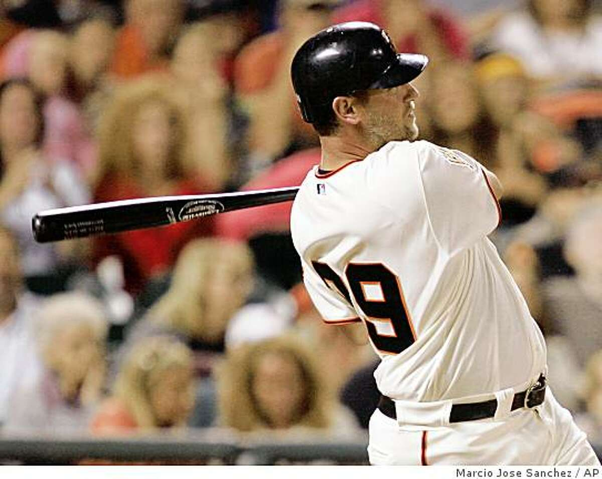 San Francisco Giants' Scott McClain hits a two-run home run off Pittsburgh Pirates relief pitcher John Grabow in the seventh inning of a baseball game in San Francisco, Saturday, Sept. 6, 2008. (AP Photo/Marcio Jose Sanchez)