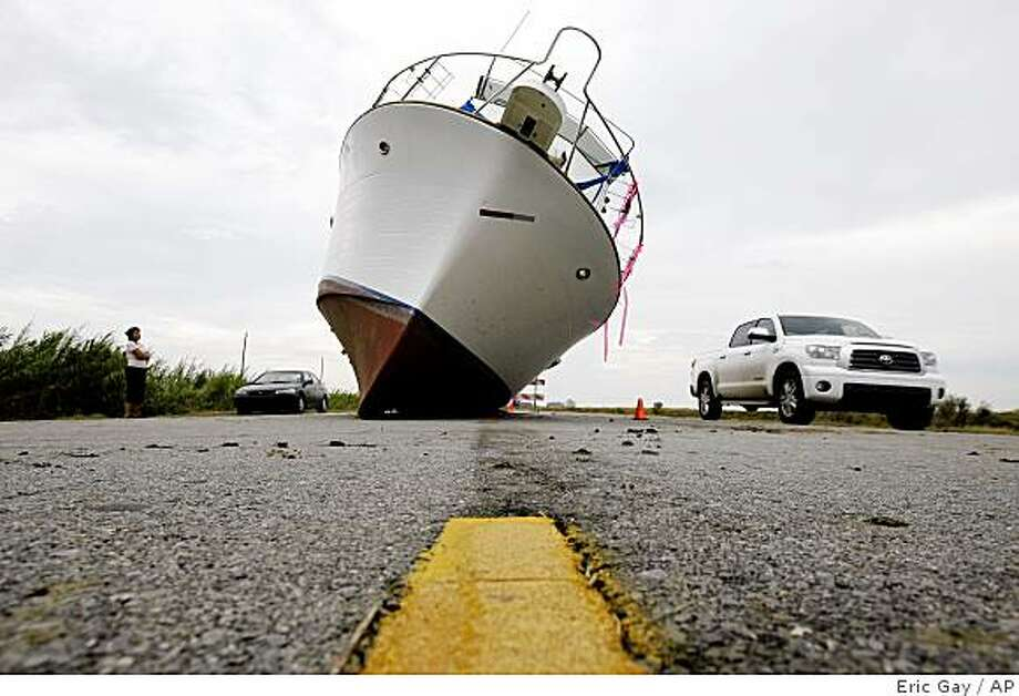 A 35-foot-long fishing boat rests on the center of Highway 90 near Ft. Pike, La., Thursday, Sept. 4, 2008. The boat was washed up to the highway from a boat yard when when Hurricane Gustav hit the area. (AP Photo/Eric Gay) Photo: Eric Gay, AP