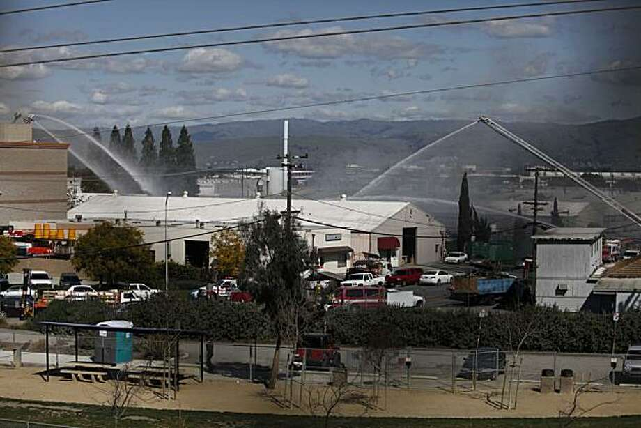 Fire crews from Santa Clara, Mt. View and San Jose work to put out a 4 alarm fire at the ECS Refinery, an electronics recycling plant, on Wednesday March 10, 2010 in Santa Clara, Calif. According to Santa Clara Fire Department Public Information Officer David Parker, nearby neighbors were told to stay indoors until potentially hazardous smoke has cleared the area. Parker also said this was the third fire of its kind at the recycling plant in the past 2 1/2 years. Nobody injuries were reported. Photo: Mike Kepka, The Chronicle