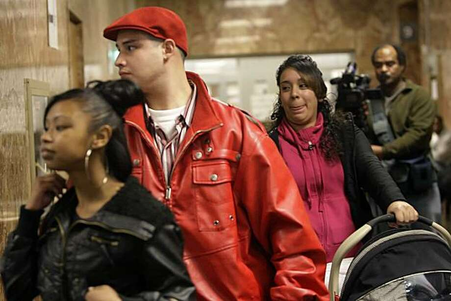 Christian Borda (second from left) walks down the hallway of the Hall of Justice after his case was dismissed in San Francisco, Calif. on Wednesday, March 10, 2010.  Some drug  defendants cases are dismissed due to the police crime lab technician allegedly stealing and using cocaine from the lab. Photo: Lea Suzuki, The Chronicle