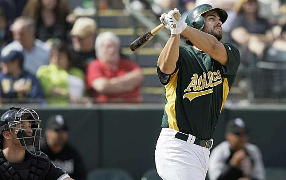 Oakland Athletics' Eric Chavez hits a solo home run against the Chicago White Sox in the sixth inning of a spring training baseball game in Phoenix, Wednesday, March 10, 2010. Photo: Jeff Chiu, AP