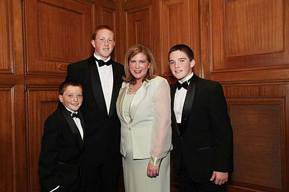 SF Fire Chief Joanne Hayes-White with her sons (from left), Sean, Riley and Logan at the American Ireland Fund Dinner. March 2010. Photo: Michael Mustacchi, Special To The Chronicle