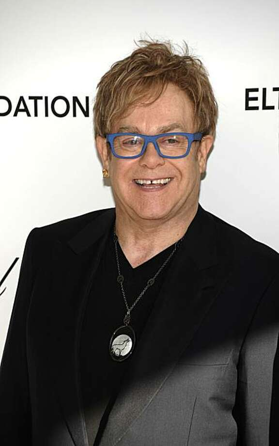 Musician Elton John arrives at the Elton John Oscar Party in West Hollywood, Calif. on Sunday, March 7, 2010. Photo: Dan Steinberg, AP