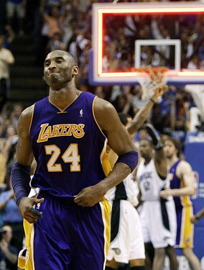 Los Angeles Lakers guard Kobe Bryant (24) runs off the court after missing a shot at the final buzzer that would have tied the score in an NBA basketball game against the Orlando Magic in Orlando, Fla., Sunday, March 7, 2010. Orlando won 96-94. Photo: John Raoux, AP