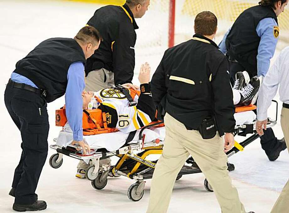 Boston Bruins' Marc Savard waves to the crowd while being carted off the ice during the third period of an NHL hockey game after a hit by Pittsburgh Penguins' Matt Cooke at Mellon Arena, Sunday, March 7, 2010, in Pittsburgh. Photo: Chaz Palla, AP