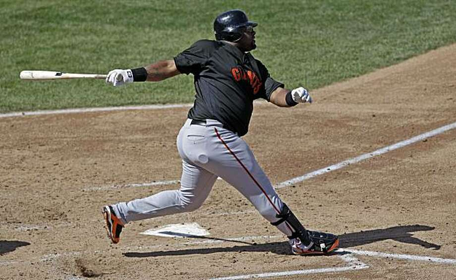 San Francisco Giants' Pablo Sandoval hits a grand slam during the third inning of a spring training baseball game against the Chicago Cubs Wednesday, March 10, 2010, in Mesa, Ariz. Photo: Morry Gash, AP