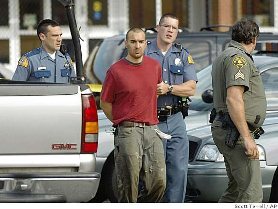 Washington State Police troopers and a Skagit County sheriff's deputy lead Isaac Zamora, 28, to the county jail, Tuesday Sept. 2, 2008 in Mount Vernon, after he led authorities on a high-speed chase from Alger. Zamora killed six people, including a sheriff's deputy. Photo: Scott Terrell, AP