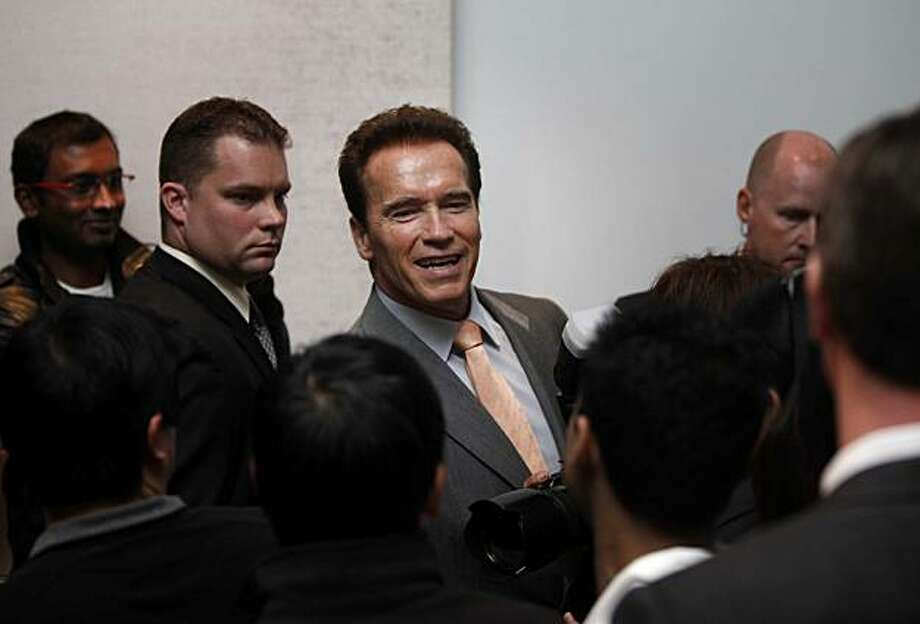 Governor Arnold Schwarzenegger shakes hands with Microsoft employees after a press conference announcing that the company will be giving away 166,000 vouchers for computer training, in the near future, on Wednesday March 10, 2010 in Mt. View, Calif. Photo: Mike Kepka, The Chronicle