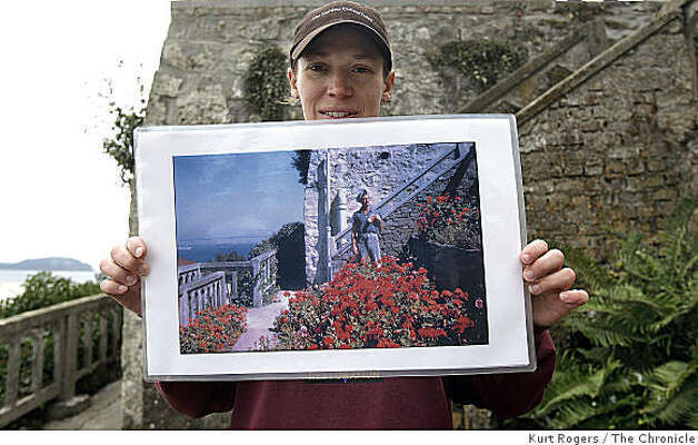 Shelaugh Fritz, a gardner with the Garden Conservancy, holds a historic photograph of one of that gardens being restored on August 5, 2008 in San Francisco, Calif. For almost a hundred years gardens dotted the island but were abandoned when the federal penitentiary closed down in 1963. Now volunteers, led by the nonprofit Garden Conservancy, are meticulously restoring Alcatraz's gardens. Photo: Kurt Rogers, The Chronicle