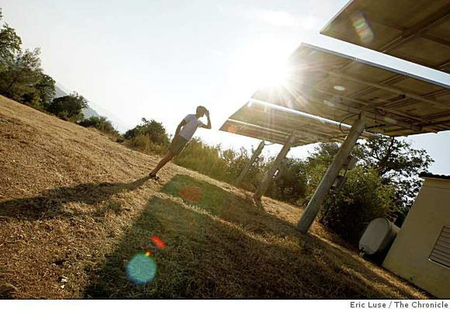 Charlie Landau and the solar panels that generate 6,000 watts for the home he and Jim Richards built  on top of a hill near San Juan, Ca. Photo: Eric Luse, The Chronicle