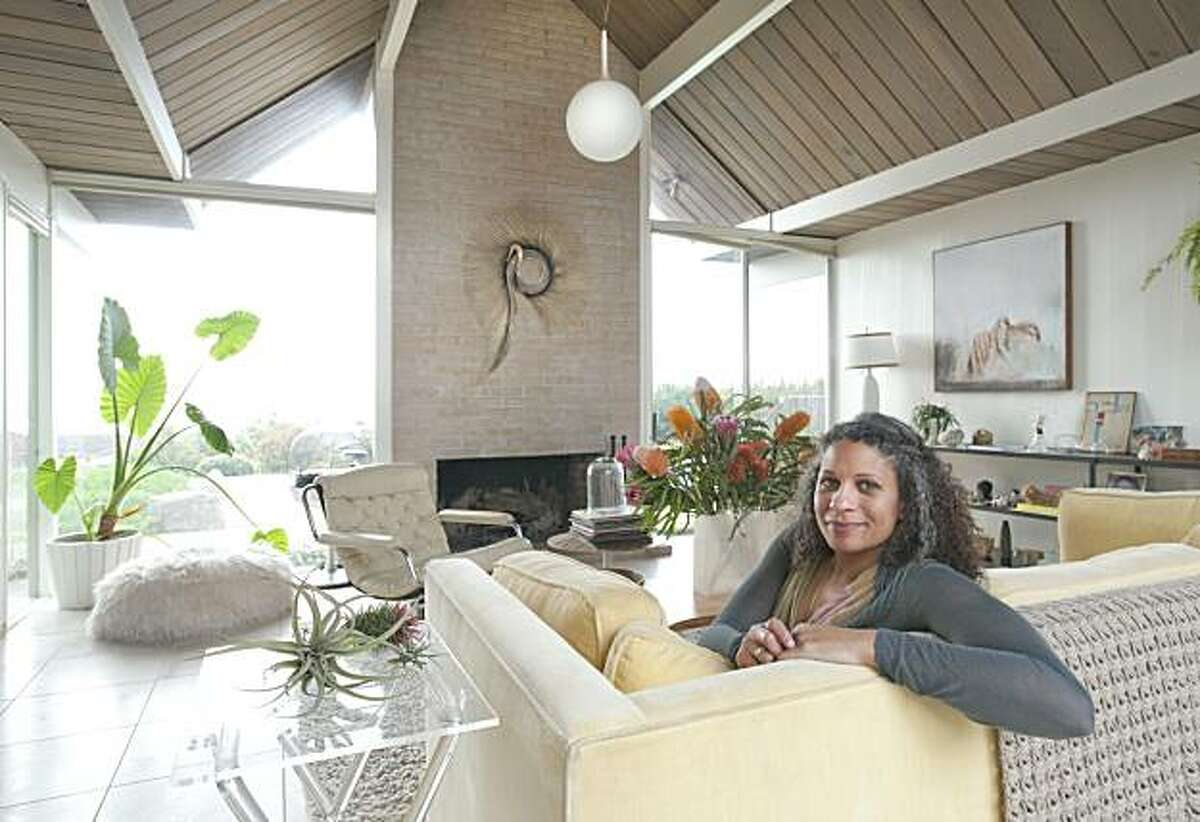 Jennifer Jones, owner of Candy Store Collective, a boutique in the Mission, poses for a portrait in her Oakland Hills Eichler home in Oakland, Calif. on Friday, Mar. 5, 2010.