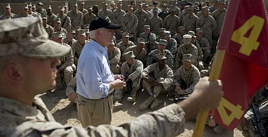 U.S. Secretary of Defense Robert Gates, center, speaks with U.S. Marines of the 3rd Battalion, 4th Marine Regiment, at Combat Out Post (COP) Cafereta near the town of Now Zad, Afghanistan, on Tuesday March 9, 2010. Photo: Jim Watson, AP
