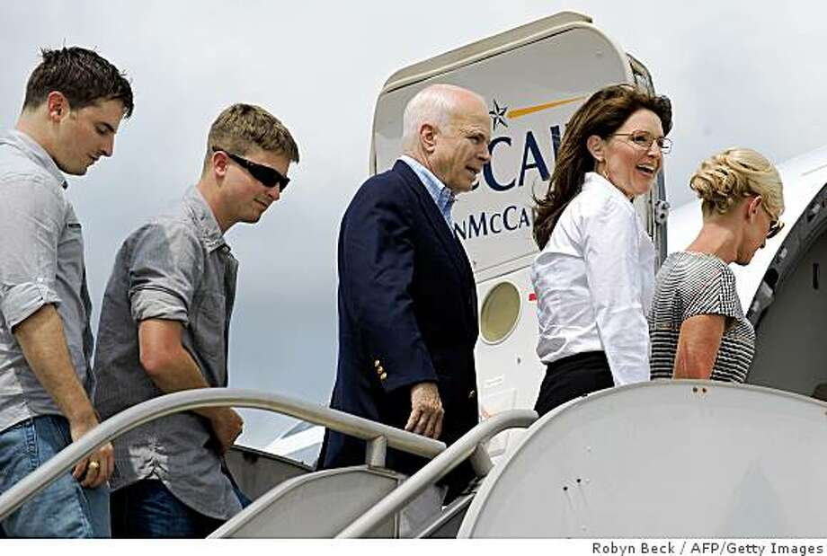 US Republican presidential candidate John McCain (C) boards his campaign airplane in Jackson, Mississippi, after a visit to the command center at the Mississippi Emergency Management Agency for an update on the situation regarding Hurricane Gustav on August 31, 2008. With McCain are, from left to right, his sons Jack and Jimmy, his running mate Alaska Governor Sarah Palin and his wife Cindy McCain.  McCain announced that there would be changes made to the September 1-4 Republican National Convention in the face of the approaching storm.          AFP PHOTO/Robyn BECK (Photo credit should read ROBYN BECK/AFP/Getty Images) Photo: Robyn Beck, AFP/Getty Images