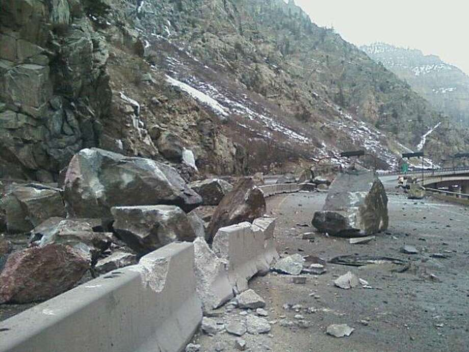 In this Monday, March 8, 2010 photo released by the Colorado Department of Transportation, a portion of a 17-mile stretch of Interstate 70, which has been closed after a rock slide, is shown in Glenwood Springs, Colo. The slide struck around midnight Sunday near the Hanging Lake Tunnel in Glenwood Canyon, a deep and narrow chasm about 110 miles west of Denver, the Colorado Department of Transportation said. (AP Photo/Colorado Department of Transportation) Photo: AP