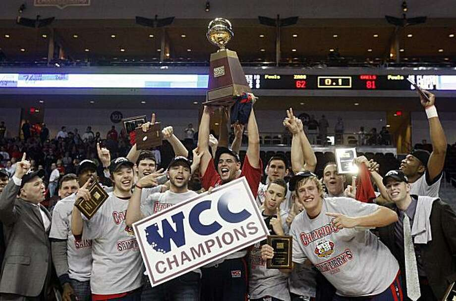 Saint Mary's Omar Samhan, center, hoists the trophy with his team after Saint Mary's defeated Gonzaga 81-62 in an NCAA college basketball game for the championship of the West Coast Conference tournament Monday, March 8, 2010, in Las Vegas. Photo: Isaac Brekken, AP