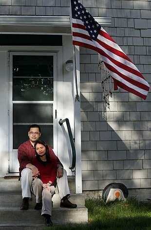 Jose and Anna Tolentino sit on the front steps of their underwater Novato condo. The couple stopped paying the mortgage in August; a foreclosure auction is slated for mid March. They're trying to negotiate with the bank for a loan modification, but they will only stay if they can get their principal balance reduced that's more in keeping with their neighborhood. Tuesday March. 2, 2010 Photo: Lance Iversen, The Chronicle