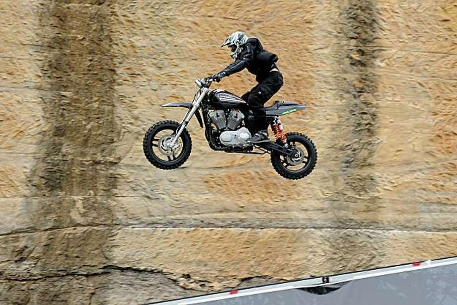 US freestyle motocross legend Seth Enslow is airborne as he smashes the longest distance record jump on a Harley-Davidson in Sydney on March 2, 2010.  Enslow broke his own new world record set only an hour earlier, with a jump of 55.77 metres (183.7 feet)on his Harley-Davidson XR1200. Photo: Greg Wood, AFP/Getty Images