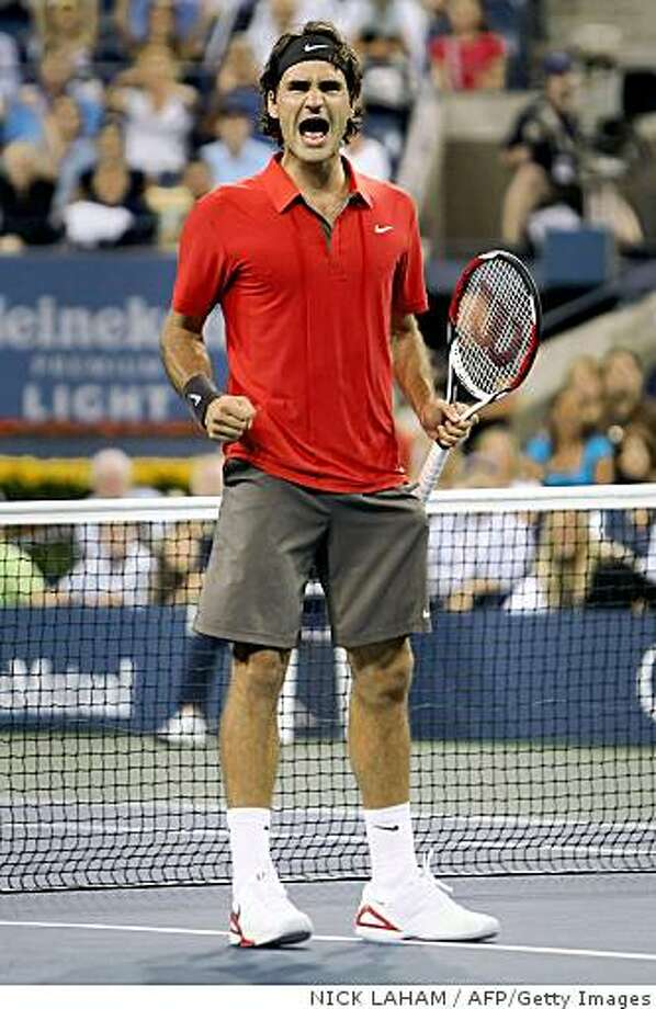 Roger Federer of Switzerland reacts after defeating Russian Igor Andreev in the fourth round of the US Open at the USTA Billie Jean King National Tennis Center on September 2, 2008 in New York. Federer won 6-7 (5/7), 7-6 (7/5), 6-3, 3-6, 6-3.          AFP PHOTO/Nick Laham/Getty Images           FOR NEWSPAPERS, INTERNET, TELCOS AND TELEVISION USE ONLY (Photo credit should read NICK LAHAM/AFP/Getty Images) Photo: NICK LAHAM, AFP/Getty Images