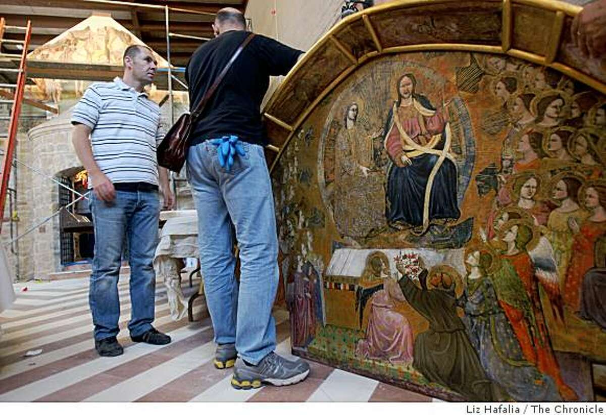 Master artist Stefano Lazzari (far left) working on a replica of a 1393 Fresco by Ilario da Viterbo, at the shrine of St. Francis in North Beach in San Francisco, Calif., on Wednesday, August 27, 2008. It's part of a recreation a replica of the famed Porziuncola Chapel in Assisi that St. Francis himself restored.